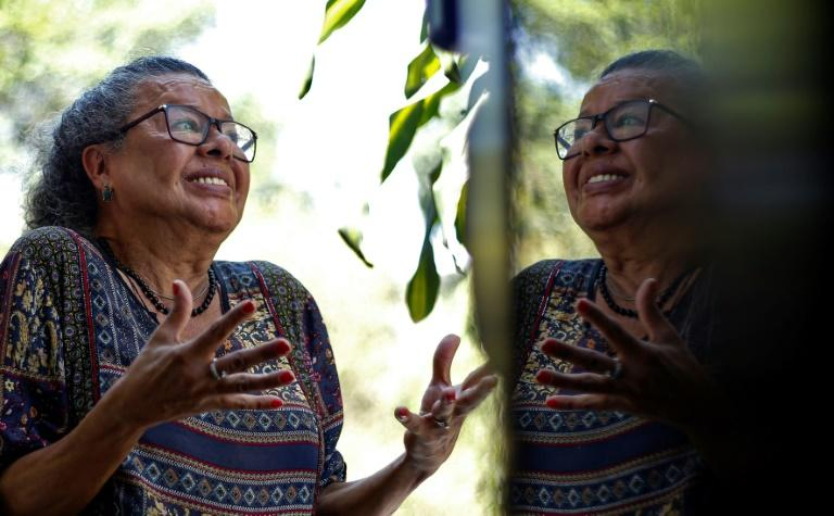 "Brazilian Thais de Azevedo, 71, a transgender person who was victim of violence and had her teeth rebuilt by the project ""Turma do Bem"", poses during an interview with AFP in Sao Paulo, Brazil"