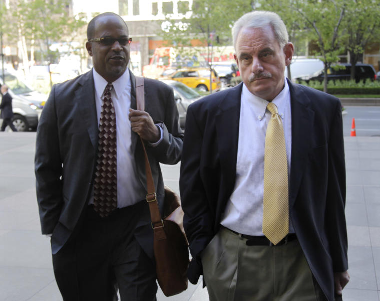 New Orleans Saints assistant coach Joe Vitt, right, arrives with attorney David Cornwell for a meeting at NFL headquarters in New York, Thursday, April 5, 2012. (AP Photo/Seth Wenig)