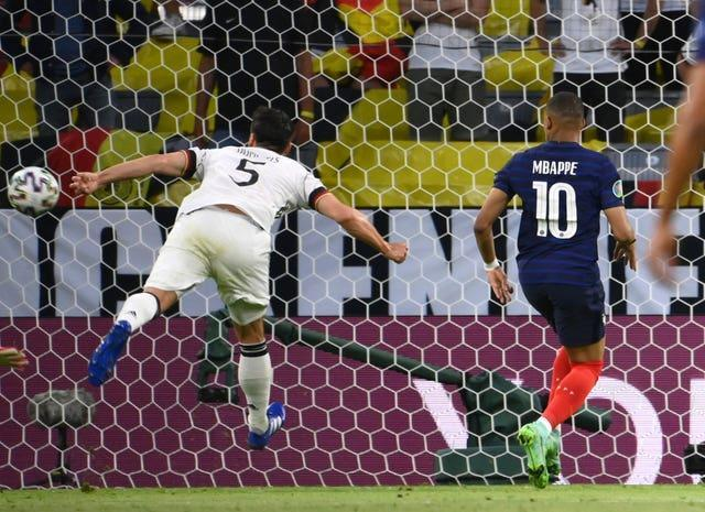 France's Kylian Mbappe (right) on as Germany's Mats Hummels scores an own goal
