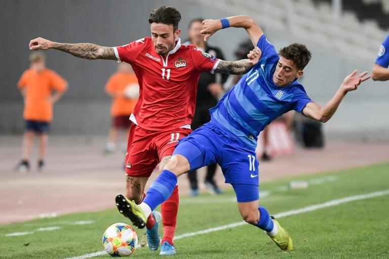 Liverpool sign Greece defender Tsimikas from Olympiakos
