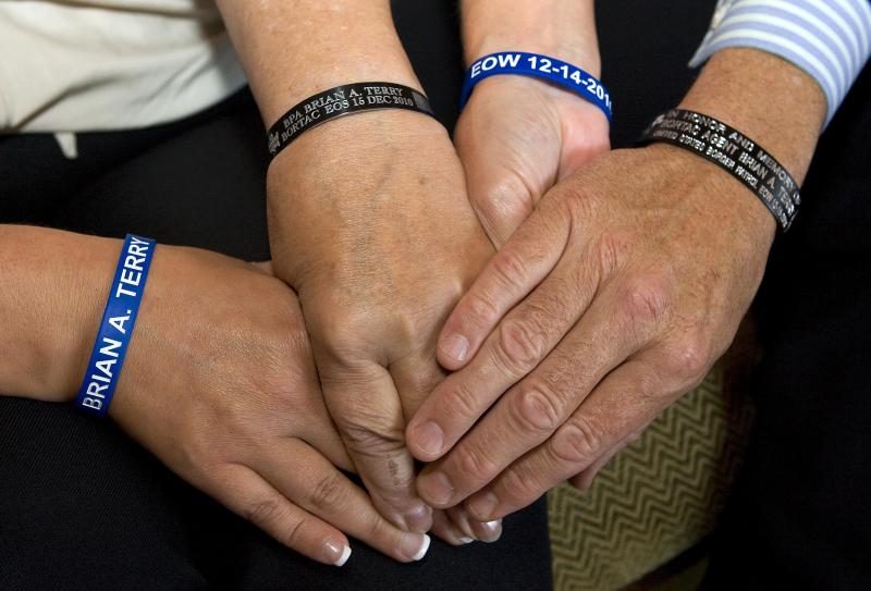 In this Sunday, Sept. 16, 2012 photo, Brian Terry's family displays wrist bracelets in Terry's honor, at the Marriott-Starr Pass Resort in Tucson, Ariz. Family members of Terry, an Arizona U.S. Border Agent killed in connection with a botched gun-smuggling operation, say they won't have closure until someone is held accountable for his death. (AP Photo/John Miller)