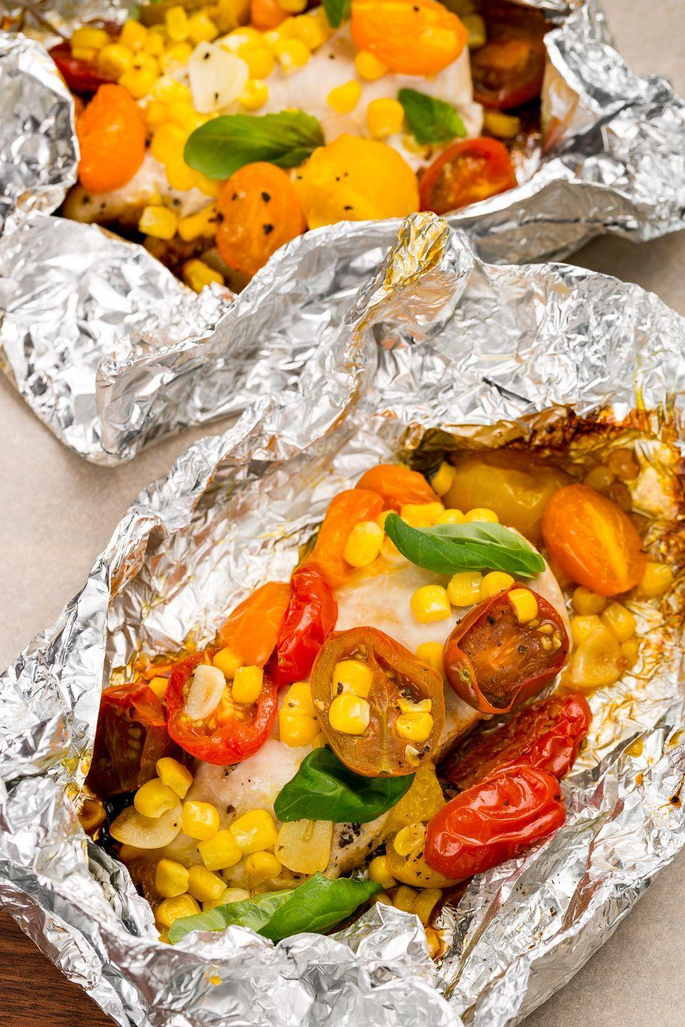 "<p>Wrap up chicken and summer veggies for a fast and super-fresh meal.</p><p>Get the recipe from <a href=""https://www.delish.com/cooking/recipe-ideas/recipes/a47496/chicken-tomatoes-and-corn-foil-pack-recipe/"" rel=""nofollow noopener"" target=""_blank"" data-ylk=""slk:Delish"" class=""link rapid-noclick-resp"">Delish</a>.</p>"