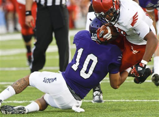 Weber State's Kela Marciel (10) tackles Eastern Washington's Jordan Talley during an NCAA college football game in Ogden, Utah, on Saturday, Sept. 22, 2012. (P Photo/Standard-Examiner, Nicholas Draney) TV OUT LOCAL TV OUT MANDATORY CREDIT