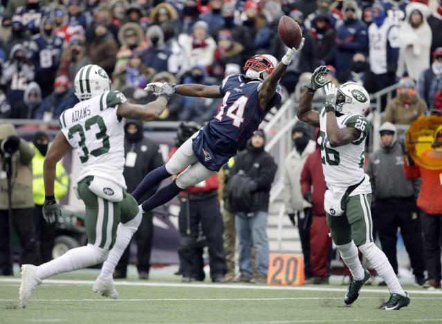 <p>New England Patriots wide receiver Brandin Cooks (14) can't make a catch between New York Jets safeties Jamal Adams (33) and Marcus Maye (26) during the first half of an NFL football game, Sunday, Dec. 31, 2017, in Foxborough, Mass. (AP Photo/Steven Senne) </p>