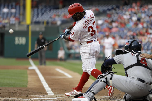Philadelphia Phillies' Odubel Herrera, left, hits a three-run home run off St. Louis Cardinals starting pitcher Miles Mikolas during the first inning of a baseball game, Monday, June 18, 2018, in Philadelphia. Cardinals catcher Yadier Molina, right, looks on. (AP Photo/Matt Slocum)