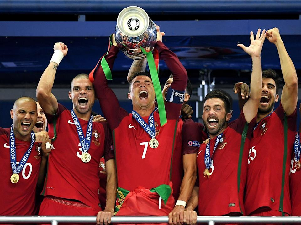 Cristiano Ronaldo, the Portugal captain, lifts the Henri Delaunay trophy in Paris five years ago (Getty)