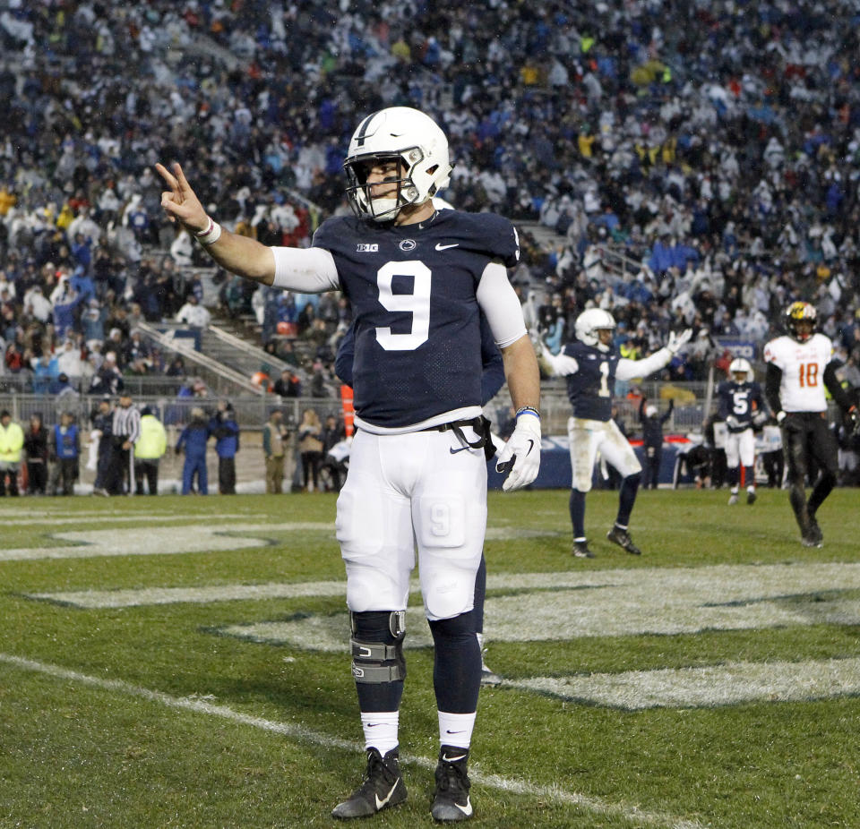 Penn State quarterback Trace McSorley (9) reacts after scoring his second rushing touchdown against Maryland on Saturday, Nov. 24, 2018. (AP Photo/Chris Knight)