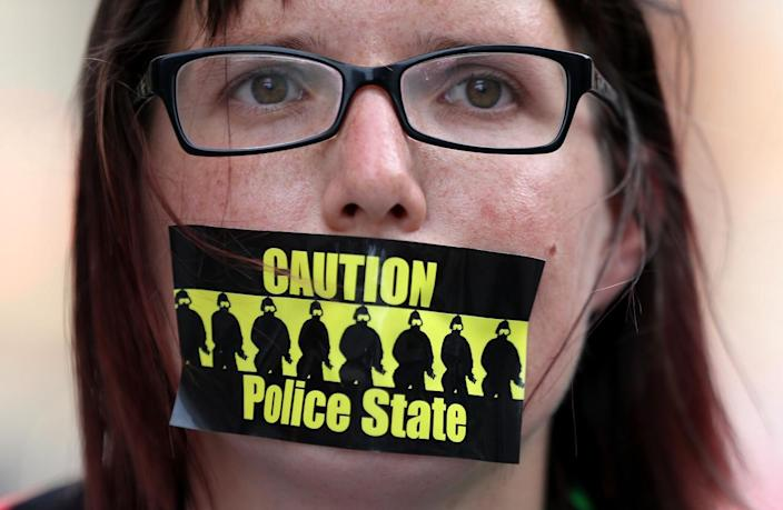 <p>A protester wears a sticker on her mouth during a demonstration near the site of the Republican National Convention on July 17, 2016, in Cleveland, Ohio. (Photo: Justin Sullivan/Getty Images)</p>