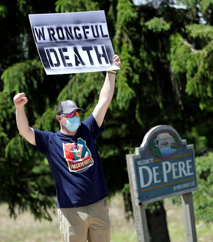 Lawrence Chetchuti, friend of Nate Lindstrom and Green Bay resident, protests along Webster Avenue outside St. Norbert Abbey on June 6, 2020, at the De Pere-Allouez border. Lindstrom, 45, said three priests sexually abused him as a teen; he died by suicide in March 2020.