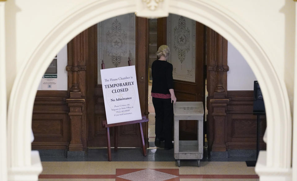 """A """"Temporarily Closed"""" sign blocks the entry to the House Chamber at the State Capitol, Tuesday, June 1, 2021, in Austin, Texas. The Texas Legislature closed out its regular session Monday, but are expected to return for a special session after Texas Democrats blocked one of the nation's most restrictive new voting laws with a walkout. (AP Photo/Eric Gay)"""