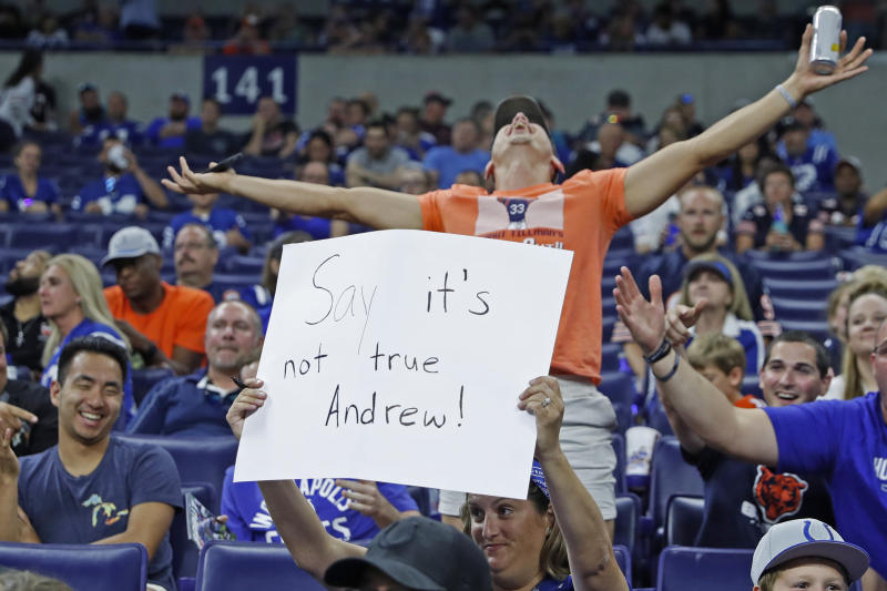 Aug 24, 2019; Indianapolis, IN, USA; A Colts fan holds up a sign as news breaks in the crowd that Indianapolis Colts quarterback Andrew Luck is going to retire after against the Chicago Bears at Lucas Oil Stadium. Mandatory Credit: Brian Spurlock-USA TODAY Sports