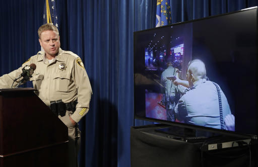 Las Vegas police Undersheriff Kevin McMahill watches body camera footage during a news conference Wednesday. (AP)