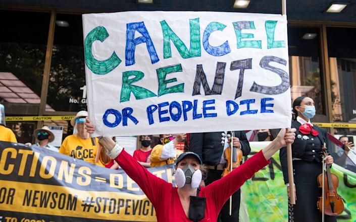 In this file photo taken on August 21, 2020, renters and housing advocates attend a protest to cancel rent and avoid evictions in front of the court house amid Coronavirus pandemic in Los Angeles, California. - Millions of Americans face could find themselves homeless starting on August 1, 2021 as a nationwide ban on evictions expires, against a backdrop of surging coronavirus cases and political fingerpointing. - AFP