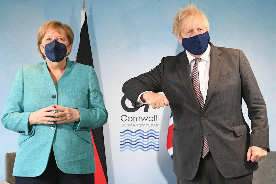 Prime Minister Boris Johnson greets German Chancellor Angela Merkel, ahead of a bilateral meeting during the G7 summit in Carbis Bay (Getty Images)