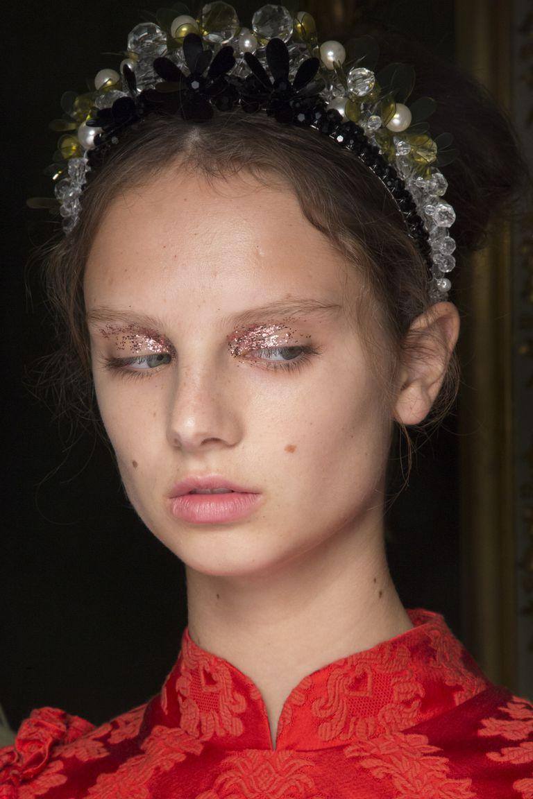 <p>Paired with little other makeup, a glittery eye and jeweled headband looks almost punk.</p>