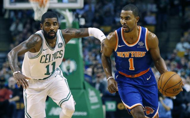 "<a class=""link rapid-noclick-resp"" href=""/nba/players/4333/"" data-ylk=""slk:Ramon Sessions"">Ramon Sessions</a> brings the ball up the court against the Celtics' <a class=""link rapid-noclick-resp"" href=""/nba/players/4840/"" data-ylk=""slk:Kyrie Irving"">Kyrie Irving</a> in an October game. (AP)"