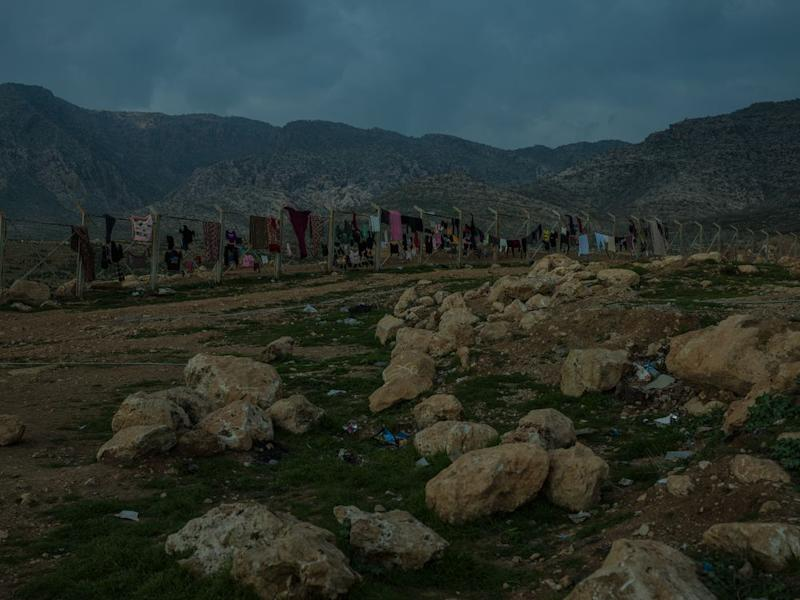 Clothes dry on a fence at a camp for displaced Yezidis near Duhok. | Newsha Tavakolian—Magnum Photos for TIME