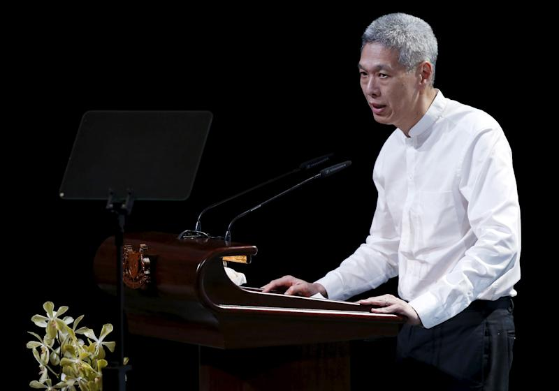 "Lee Hsien Yang, son of former leader Lee Kuan Yew, delivers his eulogy during the funeral service at the University Cultural Centre at the National University of Singapore March 29, 2015. Grieving Singaporeans were joined by world leaders on Sunday to pay their final respects to the country's first prime minister, Lee Kuan Yew, as the nation came to a near-halt to honour its ""founding father"". REUTERS/Edgar Su"