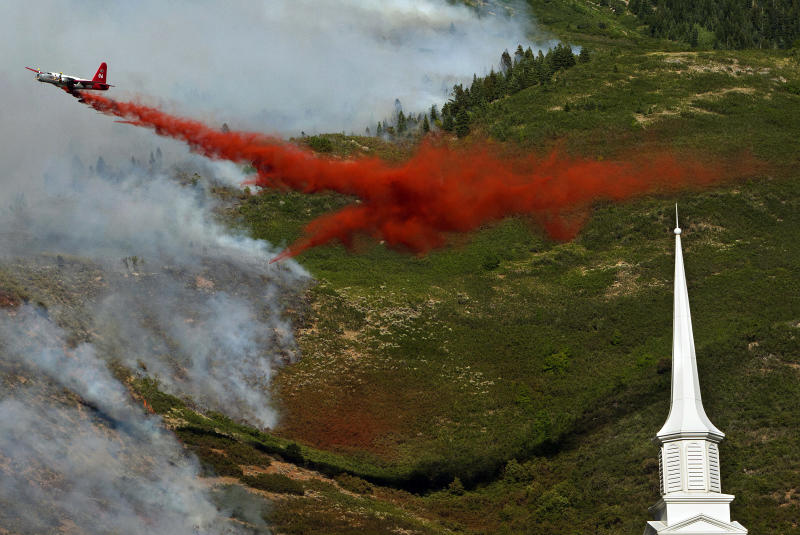 FILE - In this July 3, 2012 photo, an aircraft makes a drop on the Quail Fire above Alpine, Utah. The demise of a California company that built a device that sprays fire retardant from U.S. military C-130 cargo planes has some experts worried that a lack of spare parts and maintenance could create more problems for a program with a long record of success in fighting wildfires. Aero Union of Sacramento closed last year after the U.S. Forest Service canceled a contract worth a guaranteed minimum $14.5 million a year for six civilian air tankers, saying the company wasn't keeping up with inspections. (AP Photo/The Salt Lake Tribune, Chris Detrick )