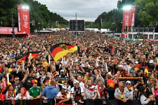 Thousands of fans gathered at the Brandenburg Gate to watch the game on giant screens
