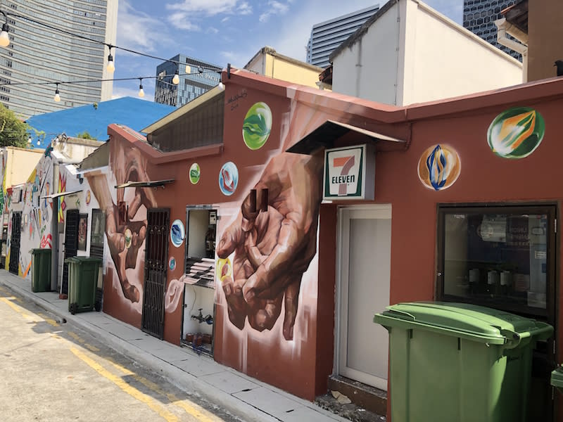 Hailing from Malaysia, Amir Andhar, who specializes in mural art painting, got his start in the art world by picking up basic techniques from his airbrush car painter father. Photo: Gelam Gallery