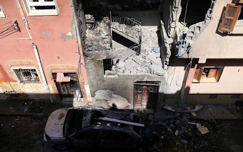 General view of a house damaged by an overnight shelling in Abu Salim district in Tripoli - REUUTERS