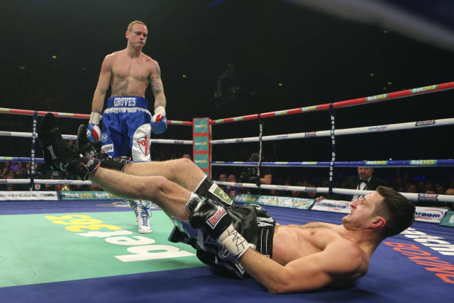Carl Froch of Britian is knocked down by compatriot George Groves during their WBA and IBF super-middleweight title fight at the Phones 4u Arena, in Manchester, England, Saturday, Nov. 23, 2013. Froch recovered from a first-round knockdown to retain his WBA and IBF super-middleweight titles with a ninth-round technical knockout of Groves in an engrossing fight on Saturday. (AP Photo/Dave Thompson, PA Wire)