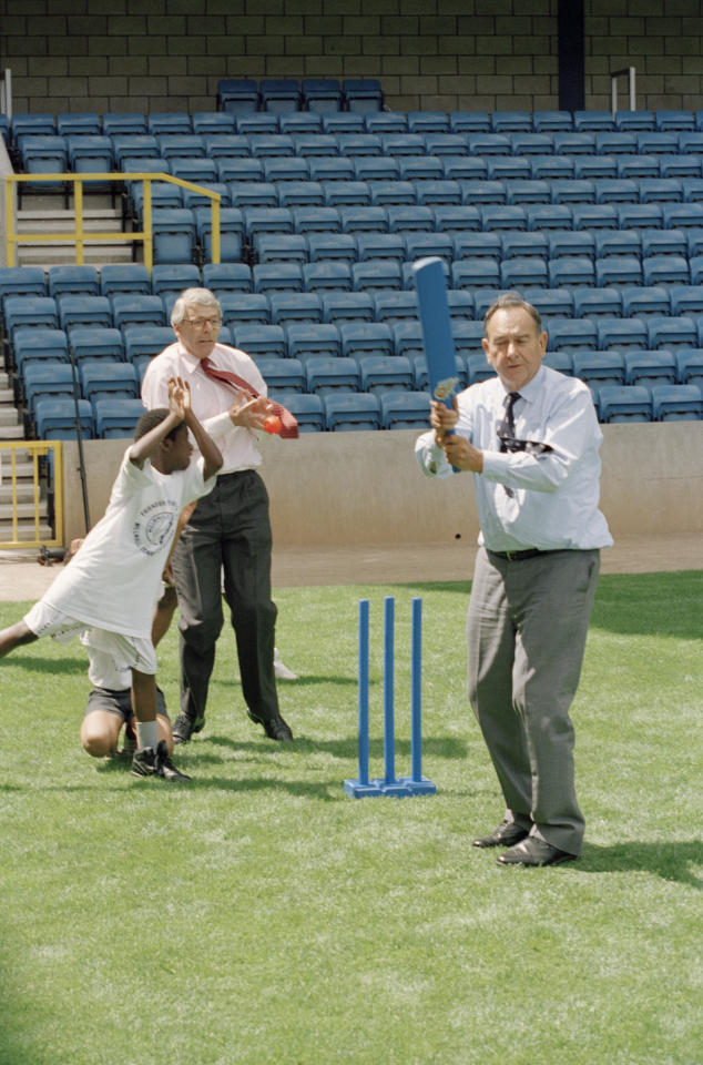 British Prime Minister John Major (left) fielding a ball from batsman Colin Cowdrey (1932 - 2000) during a cricket match at The Den, Millwall F.C.'s ground in Bermondsey, London, July 1995. (Photo by Peter Macdiarmid/Getty Images)