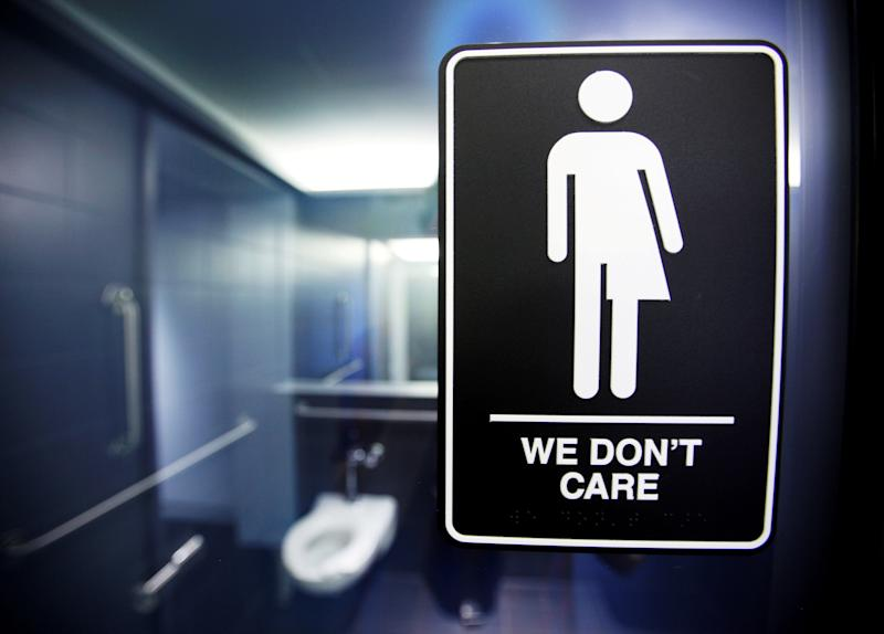 FILE PHOTO --  A sign protesting a recent North Carolina law restricting transgender bathroom access adorns one of the stalls at the 21C Museum Hotel in Durham, North Carolina
