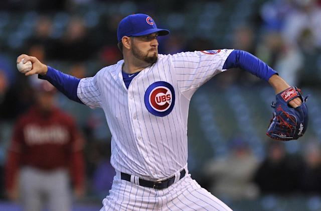 Chicago Cubs starter Jason Hammel delivers a pitch during the first inning of a baseball game against the Arizona Diamondbacks in Chicago, Tuesday, April 22, 2014. (AP Photo/Paul Beaty)