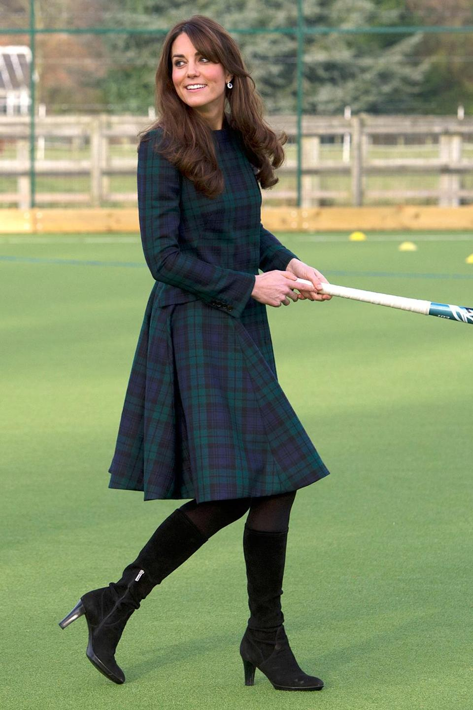 <p>Kate got sporty during a November 2012 outing despite wearing heels and a tartan patterned dress coat.</p>