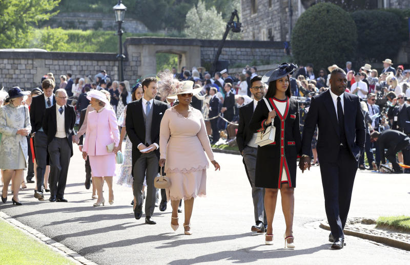 Idris Elba, right, and Sabrina Dhowre followed by Oprah Winfrey, forth right, arrive for the wedding ceremony of Prince Harry and Meghan Markle at St. George's Chapel in Windsor Castle in Windsor, near London, England, Saturday, May 19, 2018. (Chris Radburn/pool photo via AP)
