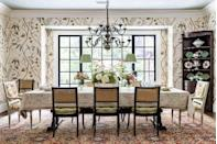 """<p>""""Imagine a garden painting. The garden's ground is alive with blooming groundcovers. Then a vine grows vertically upward. The sky is a perfect shade of blue. That's what we were hoping to achive with the design of this dining room.""""</p><p>An antique Persian rug is the grounding of this """"garden."""" The <a href=""""https://www.lewisandwood.co.uk/"""" rel=""""nofollow noopener"""" target=""""_blank"""" data-ylk=""""slk:Lewis and Wood"""" class=""""link rapid-noclick-resp"""">Lewis and Wood</a> wallpaper is truly a vine motif growing up to the sky. The ceiling is lacquered in a sky blue (<a href=""""https://www.benjaminmoore.com/en-us/color-overview/find-your-color/color/CW-640/pearl?color=CW-640"""" rel=""""nofollow noopener"""" target=""""_blank"""" data-ylk=""""slk:Pearl by Benjamin Moore"""" class=""""link rapid-noclick-resp"""">Pearl by Benjamin Moore</a>). Pops of garden-fresh green are carried throughout, from the lampshades to the majolica plates. </p>"""