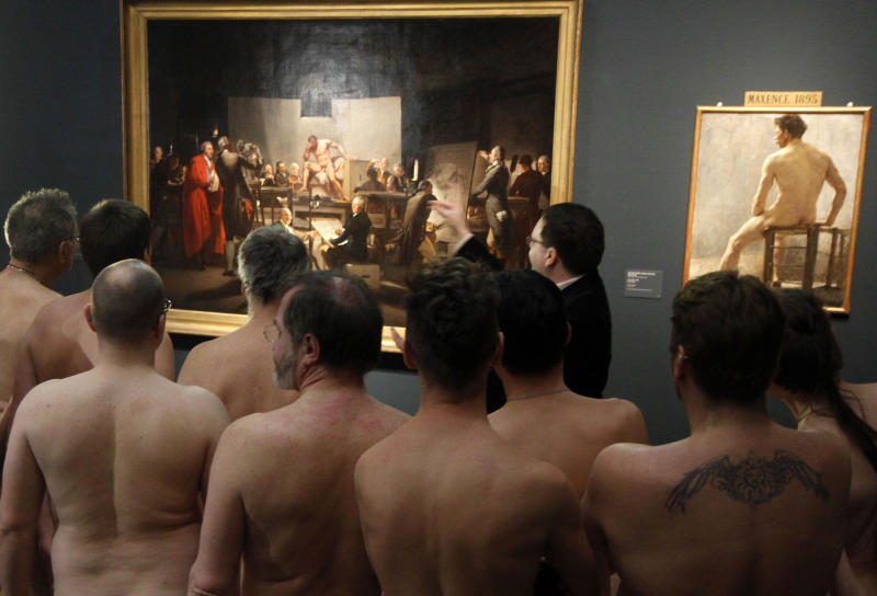"RETRANSMISSION  OF XRZ102 In this Monday, Feb. 18, 2013 photo, Naked Museum visitors look at pictures of the show ""Nude Men from 1800 to Today"" during a special opening to friends of nudism at the Leopold Museum, Vienna, Austria. The show ""Nude Men from 1800 to Today"" opened its doors from 19 October 2012 to  March  4,2013, looking at how artists have dealt with the theme of male nudity over the centuries. (AP Photo/Ronald Zak)"
