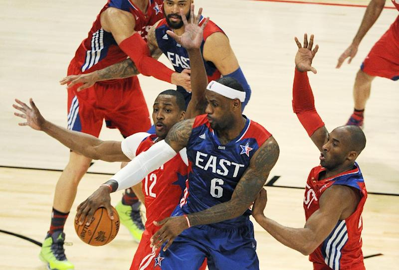 East Team's LeBron James of the Miami Heat, drives against West Team's LaMarcus Aldridge of the Portland Trail Blazers and Kobe Bryant of the Los Angeles Lakers, right, during the first half of the NBA All-Star basketball game Sunday, Feb. 17, 2013, in Houston. (AP Photo/Pat Sullivan)