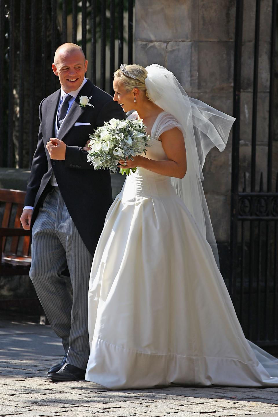 <p>Mike Tindall and Zara Phillips leaving after their Royal wedding at Canongate Kirk on 30 July, 2011 in Edinburgh. (Jeff J Mitchell/Getty Images)</p>