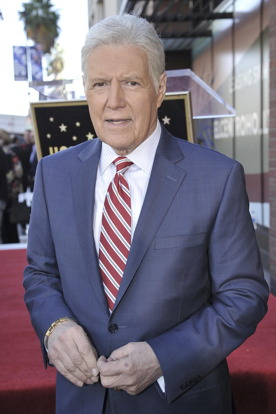 """FILE - Alex Trebek, host of """"Jeopardy!"""" attends a ceremony honoring the show's executive producer Harry Friedman with a star on the Hollywood Walk of Fame on Nov. 1, 2019, in Los Angeles. More than two months after Trebek's death, fans of """"Jeopardy!"""" finally got the chance to say goodbye. A video tribute to the host opened the Friday, Jan. 8, 2021, episode of the quiz show, the final one that Trebek taped before pancreatic cancer claimed his life on Nov. 8. (Photo by Richard Shotwell/Invision/AP, File)"""