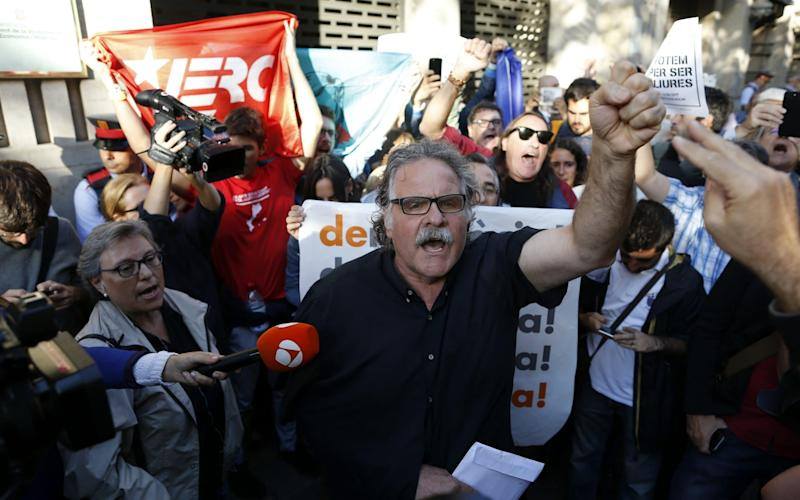 Republican Left of Catalonia party's (ERC) Member of Parliament Joan Tarda at a demonstration outside the regional Economy Ministry in Catalonia during a police search for documents connected with the organisation of the Catalan independence referendum, in Barcelona, Spain - EFE