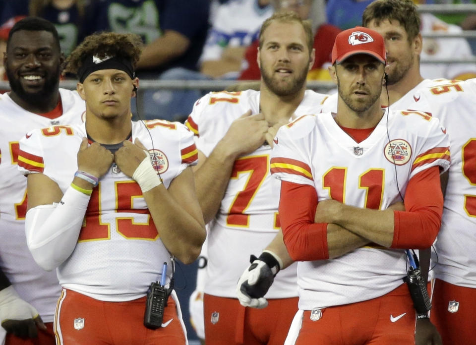 Kansas City Chiefs quarterback quarterback Alex Smith, right, stands on the sideline with backup quarterback Patrick Mahomes, left, during a 2017 preseason game in Seattle. (AP Photo/Elaine Thompson, File)