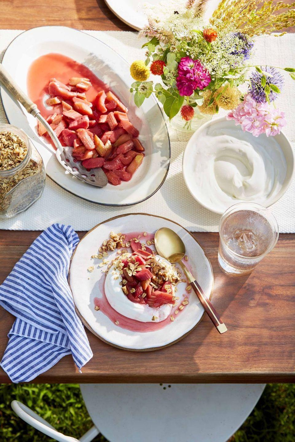 """<p>Extra tart rhubarb, poached in maple syrup, makes a delicious and elegant topping for your favorite breakfast yogurt.</p><p><strong><a href=""""https://www.countryliving.com/food-drinks/a32353901/poached-rhubarb-with-yogurt/"""" rel=""""nofollow noopener"""" target=""""_blank"""" data-ylk=""""slk:Get the recipe"""" class=""""link rapid-noclick-resp"""">Get the recipe</a>.</strong></p>"""