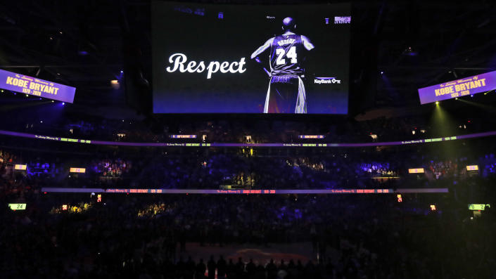 A tribute to Kobe Bryant is played during a moment of silence before an NBA basketball game between the Cleveland Cavaliers and the New Orleans Pelicans, Tuesday, Jan. 28, 2020, in Cleveland. (AP Photo/Tony Dejak)
