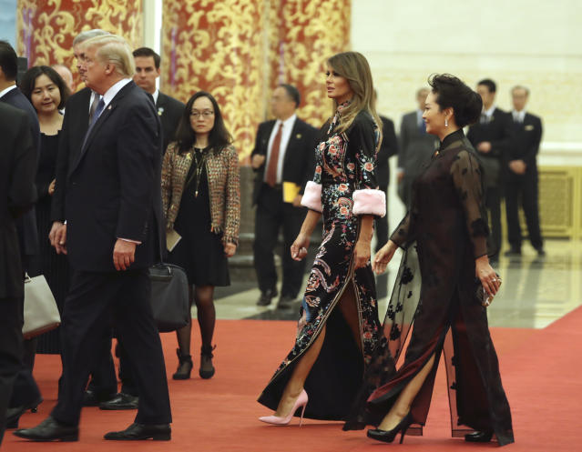 President Donald Trump, accompanied by first lady Melania Trump and Chinese first lady Peng Liyuan, arrives for a state dinner at the Great Hall of the People on Nov. 9, in Beijing. Trump is on a five-country trip through Asia traveling to Japan, South Korea, China, Vietnam, and the Philippines. (Photo: AP Photo/Andrew Harnik)