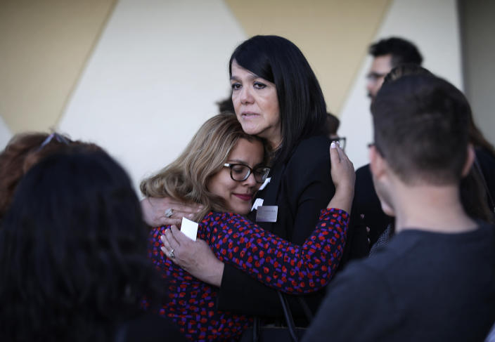 <p>Maritza Rodriguez, right, embraces Emily Zamora after a special service at Guardian Angel Cathedral for the mass shooting on the Las Vegas Strip, Monday, Oct. 2, 2017, in Las Vegas. (Photo: John Locher/AP) </p>
