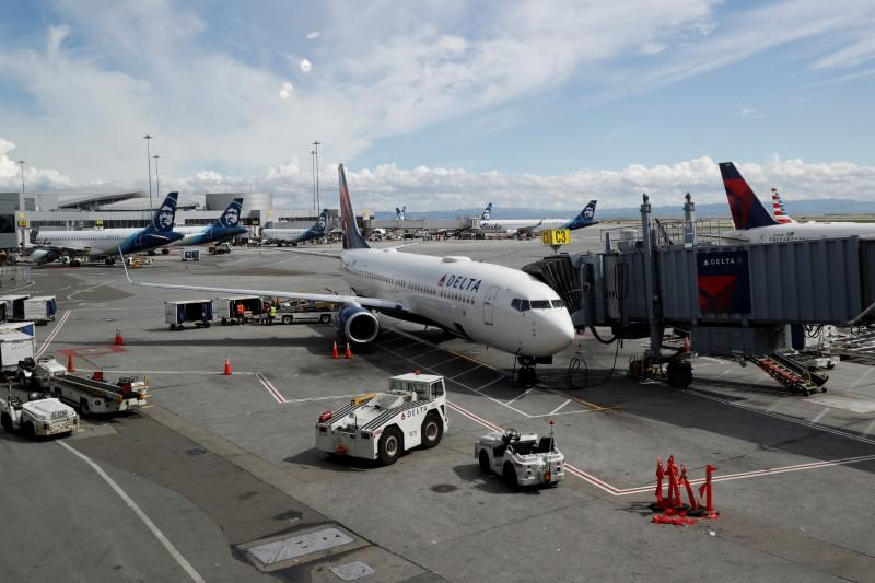 FILE PHOTO: Planes are seen parked at gates at San Francisco International Airport