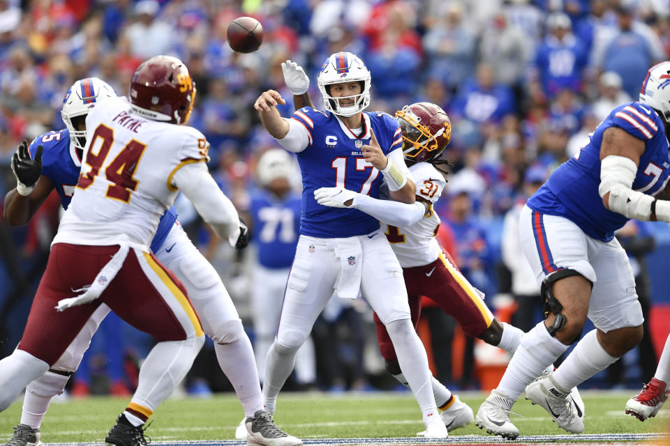 Washington Football Team's Kamren Curl (31) hits Buffalo Bills quarterback Josh Allen (17) who throws a pass during the second half of an NFL football game Sunday, Sept. 26, 2021, in Orchard Park, N.Y. (AP Photo/Adrian Kraus)