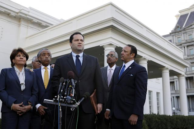 Civic leaders, from left, National Council of La Raza President Janet Murguia; Rev. Al Sharpton of the National Action Network; NAACP President Ben Jealous; AARP CEO Barry Rand; and National Urban League President Marc Morial, speak to reporters outside the White House in Washington, Nov. 16, 2012, after meeting with President Barack Obama. (Photo: Jacquelyn Martin/AP)