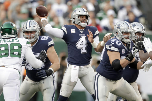Dallas Cowboys quarterback Dak Prescott looks to throw during the first half of an NFL football game against the New York Jets, Sunday, Oct. 13, 2019, in East Rutherford, N.J. (AP Photo/Adam Hunger)