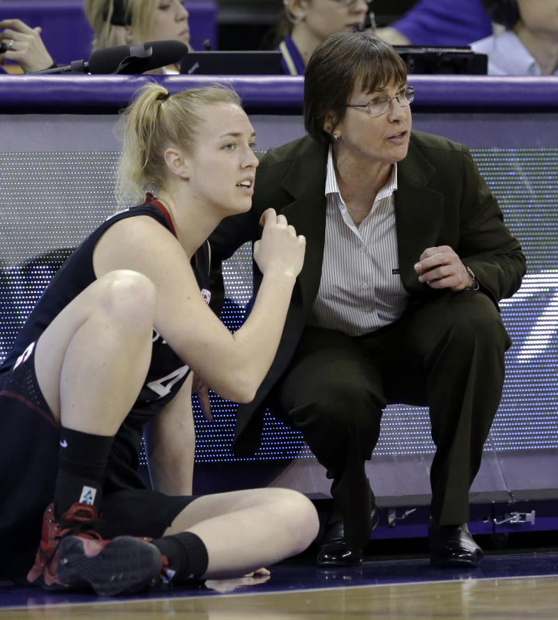 Stanford head coach Tara VanDerveer, right, talks with Taylor Greenfield as Greenfield readies to enter the NCAA college basketball game against Washington Thursday, Feb. 28, 2013, in Seattle.  Stanford won 71-36. (AP Photo/Elaine Thompson)