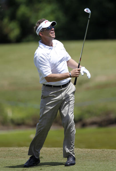 New Orleans Saints NFL football head coach Sean Payton watches his drive during Pro-Am rounds of the PGA golf Zurich Classic at TPC Louisiana in Avondale, La., Wednesday, April 25, 2012. (AP Photo/Gerald Herbert)