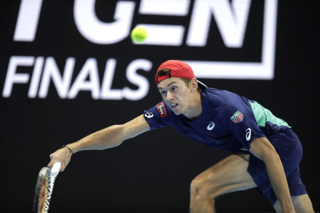Alex De Minaur of Australia returns the ball to Jannik Sinner of Italy, during the ATP Next Gen tennis tournament final match, in Milan, Italy, Saturday, Nov. 9, 2019. (AP Photo/Luca Bruno)